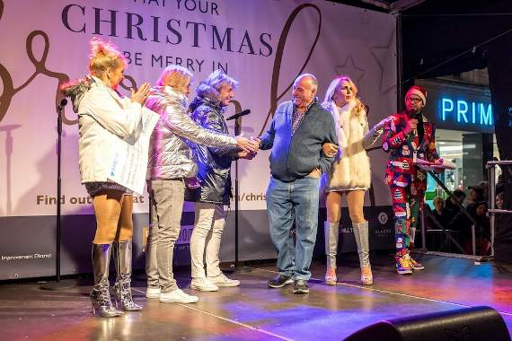 Street cleaner Colin is crowned Bromley's local hero, turning on the town's Christmas lights with The Fizz